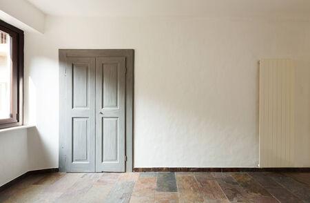 closed door in a rustic house, stone floor photo
