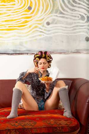 sexy food: sexy girl eating spaghetti on the couch Stock Photo