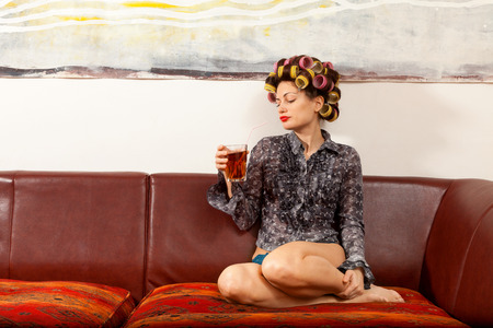 knickers: sexy girl with drink on the couch in the living room
