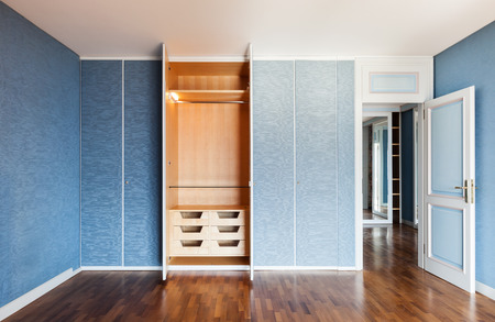 Interior, apartment empty in style classic, room with wardrobes photo