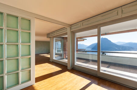 Interior, empty  apartment in style classic, large windows overlooking the lake photo