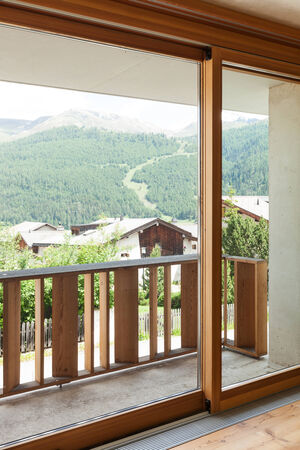 chalets: new apartment in cement and wood, window Stock Photo