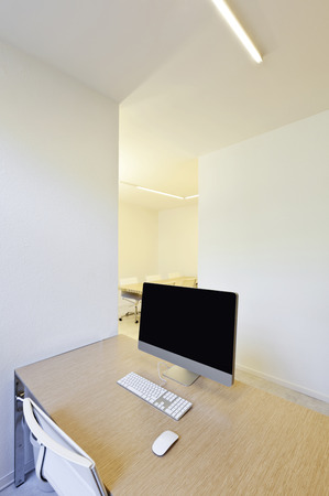 modern office interior design, workplace with computers  photo