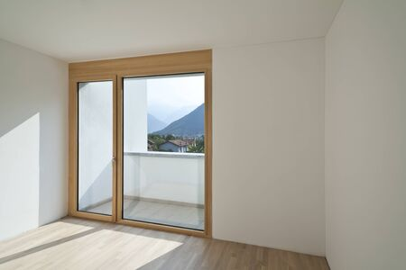 empty room with window and parquet  photo