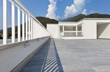 banister: large terrace of a modern white house