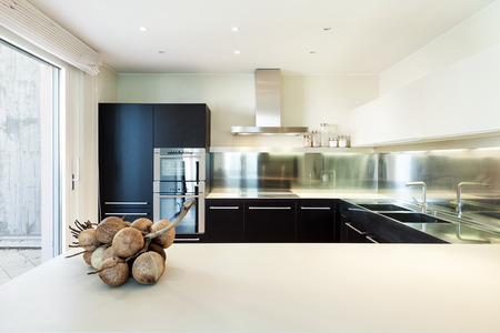 stainless steel kitchen: interior luxury apartment, beautiful modern kitchen