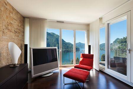 veranda: interior luxury apartment, comfortable red armchair