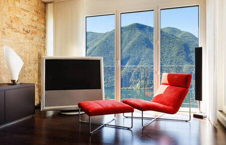 furniture detail: interior luxury apartment, comfortable red armchair Stock Photo