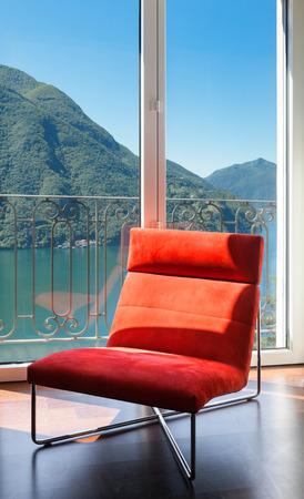 interior luxury apartment, comfortable red armchair photo