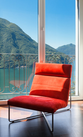 luxury apartment: interior luxury apartment, comfortable red armchair Stock Photo