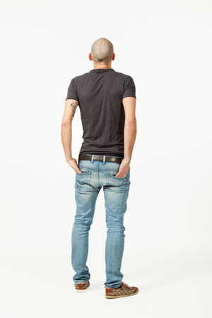 portrait of  young man in studio, back view Stock Photo