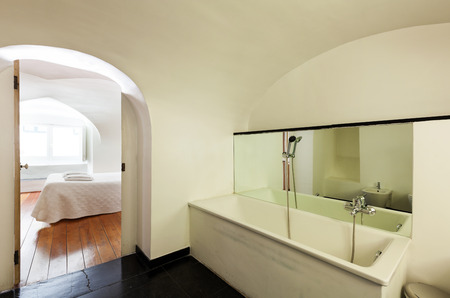 hotel bathroom: hotel in historic palace, interior, view bedroom from bathroom