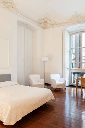 white room: beautiful hotel room in old historic building, double room Stock Photo
