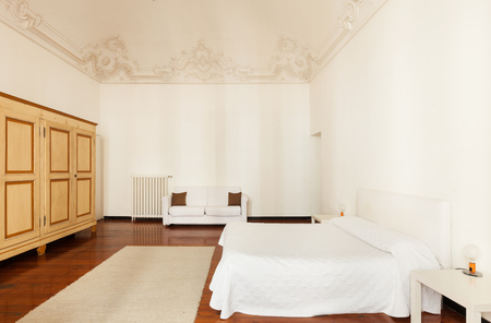 view an elegant wardrobe: view of classic bedroom in a hotel  Stock Photo