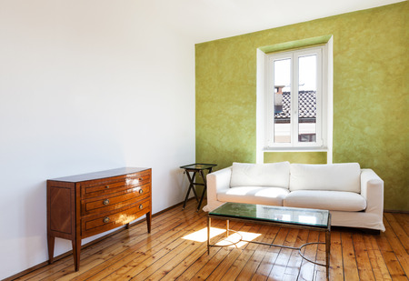 vintage living room: home interior, view white sofa and window  Stock Photo