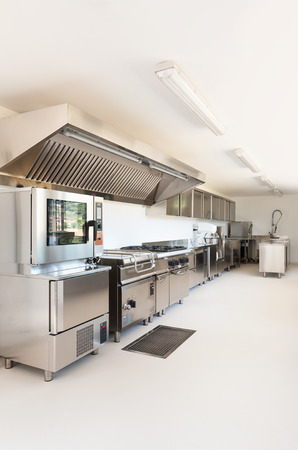 Professional kitchen in new building photo