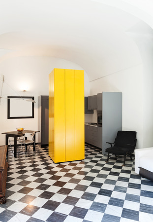 apartment in old building, interior, checkered floor photo