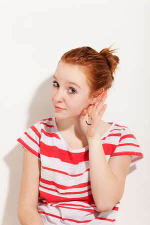 redheaded: portrait of cute redheaded girl, background wall