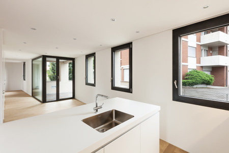 interior new house, modern white kitchen, view room with windows photo