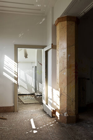abandoned building, empty room with column photo