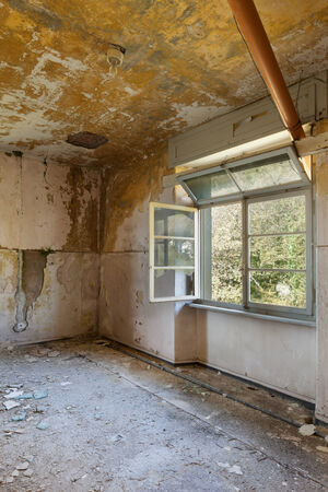 old destroyed building, room with window photo