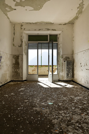 abandoned building, empty room with window photo