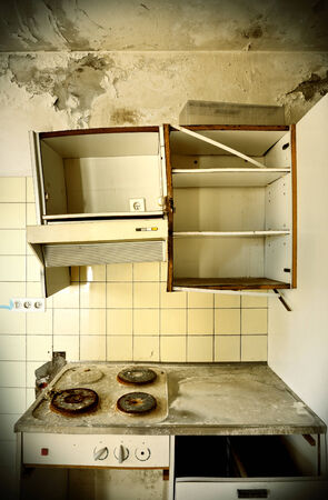 deserted: old kitchen destroyed, interior abandoned house  Stock Photo