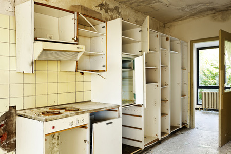old kitchen destroyed, interior abandoned house  Stock Photo