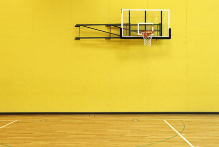 architecture building: public school, yellow wall and basket, interior