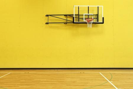school gym: public school, yellow wall and basket, interior