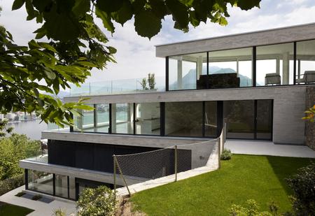 modern garden: beautiful modern house, view from garden