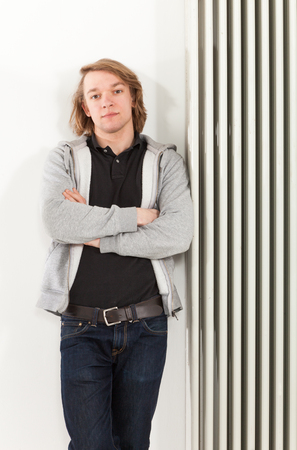 portrait of young man leaning on the radiator photo