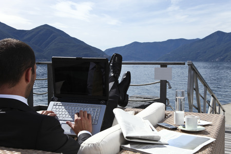 one businessman are relax in front of the lake photo