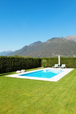 Modern villa with pool, view from the garden Reklamní fotografie