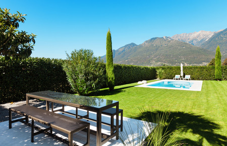 Modern villa with pool, view from the garden photo