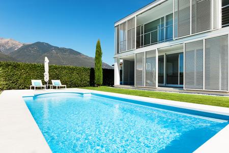 blue facades sky: Modern villa with pool, view from the garden Stock Photo