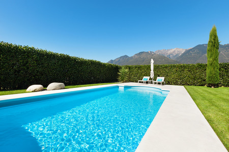 hedges: Modern villa with pool, view from the garden Stock Photo