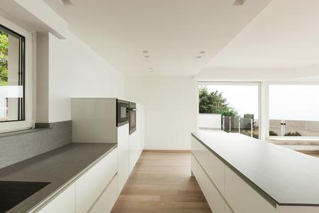 kitchen island: beautiful new apartment, interior, modern kitchen Stock Photo