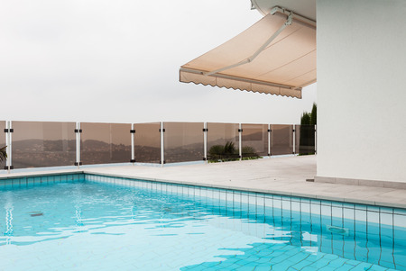 an awning: beautiful new apartment building, outdoor, pool view