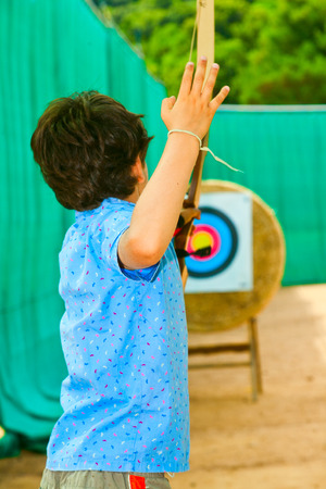 archery: child pulls with a arc Stock Photo