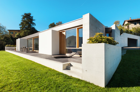 beautiful modern house in cement, view from the garden photo