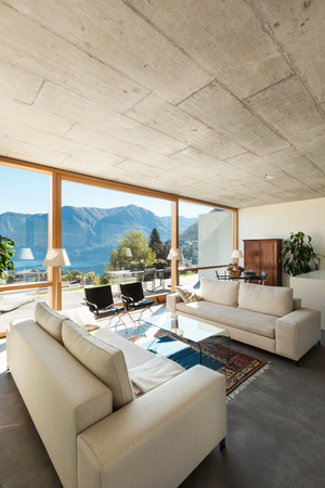view of an elegant living room: beautiful modern house in cement, interiors, view from the living room