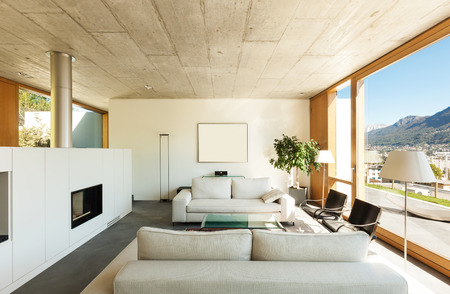 modern lifestyle: beautiful modern house in cement, interiors, view from the living room