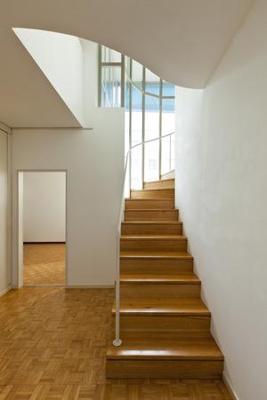 duplex: Bright duplex with hardwood floors,wooden stair