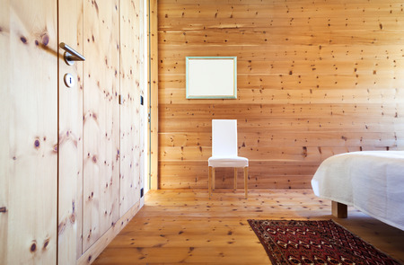 view of a comfortable bedroom: interior new house, view of the bedroom wooden