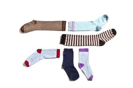 useless: old socks, isolated on white background Stock Photo