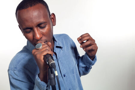 jazz singer: African singer with microphone on white background