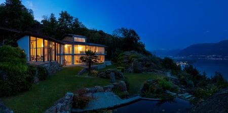 alight: Night landscape with alight villa