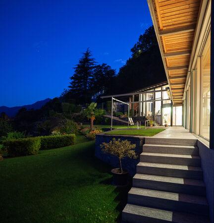 alight: Night landscape with alight villa, steps and veranda Stock Photo