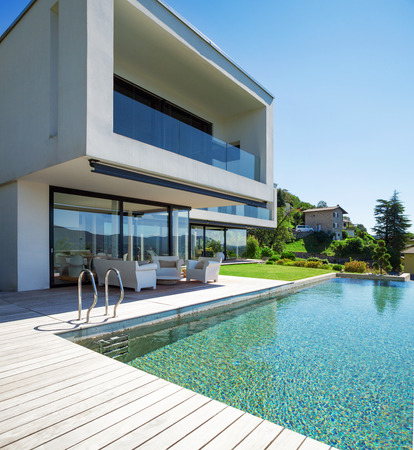 building exterior: Modern house with pool in exterior